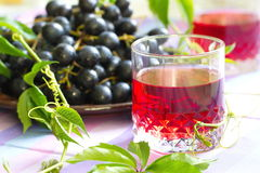 Red grapes and grape juice Stock Photo