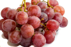 Red grapes isolated on white Stock Photos