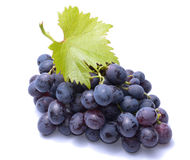 Red grapes with leaves isolated on white background Stock Photo