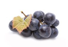 Red grapes with leaves isolated on white background Royalty Free Stock Photos