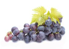 Red grapes with leaves isolated on white background Stock Image
