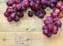 Red grapes on old wood table Stock Photography