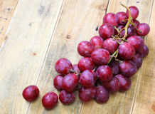 Red grapes on old wood table Stock Images