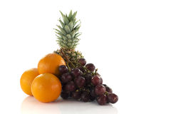 Red grapes oranges and pineapple Royalty Free Stock Photos