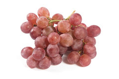 Red grapes over white background. Royalty Free Stock Photos