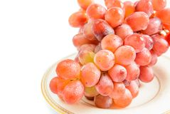 Red grapes on a plate Royalty Free Stock Image