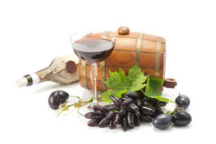 Red grapes , plums and red wine. Royalty Free Stock Photos