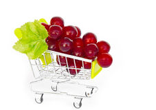 Red grapes in shopping cart. Royalty Free Stock Photography