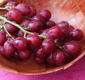 Red Grapes. Some fresh red grapes in a bowl royalty free stock photography