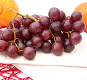 Red grapes. Some red grapes on a white plate stock photo