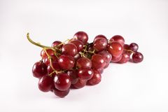 Red grapes with stalks isolated on white background. Fresh red grapes Royalty Free Stock Photos