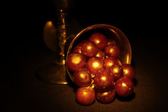Red Grapes. In a tarnished silver goblet Royalty Free Stock Photography