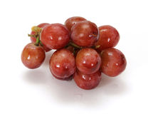 Red Grapes on White Background. Freshly washed red grapes isolated on white royalty free stock photography