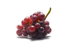 Red grapes on white background Royalty Free Stock Images