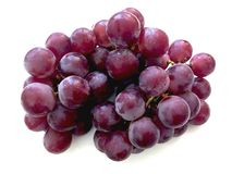 Red grapes on a white background royalty free stock photos