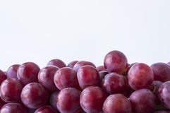 Red grapes on white background. Top view.  Bunch of grape on white background. Pink bunch grape on white stock photography