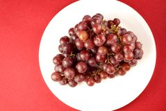 Red Grapes on White Plate Stock Photography