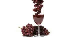 Red grapes and wine royalty free stock photos