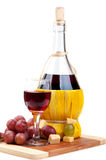 Red grapes and wine bottle Stock Photos