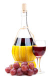 Red grapes and wine bottle Royalty Free Stock Photo
