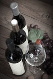 Red grapes with wine bottles Stock Photo