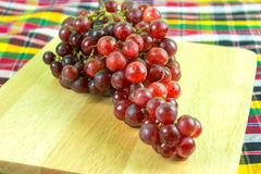 Red grapes on a wood background. Royalty Free Stock Images
