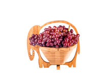 Red Grapes in wooden basket Royalty Free Stock Image