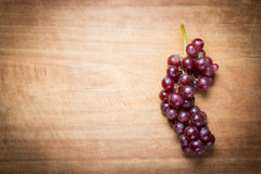 Red Grapes on a wooden table Royalty Free Stock Photos