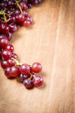 Red Grapes on a wooden table Stock Images
