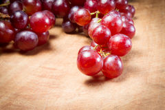 Red Grapes on a wooden table Stock Image