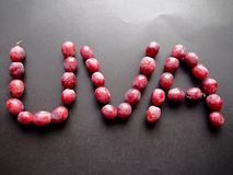 Red grapes writing grape in Spanish Royalty Free Stock Image