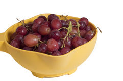 Red Grapes in a yellow bowl Stock Photo