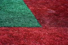 Red and green grass. Abstract textured background of red and green grass on lawn Royalty Free Stock Photo