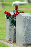 Red grave flowers. Red flowers in a cemetery Stock Photo