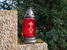 Red grave lantern with golden cross Stock Photos