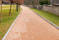Red gravel path in the park Stock Image