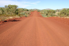 Red gravel road. Wide angle view at red gravel country road in Australia stock image