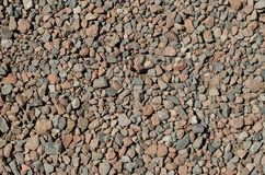 Red gravel texture. Gravel texture consisting of light and dark stones royalty free stock images