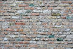 Red gray brick wall, brick wall with colorful colored bricks,red wall texture, as background stock image