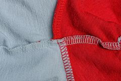 Red gray cloth texture from a crumpled piece of fabric. With a seam stock photography