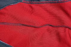 Red gray cloth texture from a crumpled piece of fabric. With a seam royalty free stock image