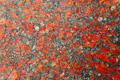 Red and gray granite background with beautiful nuances. High Polished Red Granite Texture. Red Base with Black and Gray Spots. Close up of a polished red Stock Photo
