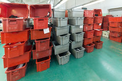 Red and gray plastic boxes. Stacks of red and gray plastic boxes, shoe factory Royalty Free Stock Photos