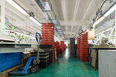Red and gray plastic boxes. Stacks of red and gray plastic boxes, shoe factory stock photo