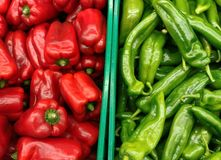 Red and gree peppers. Green and red peppers in a supermarket ready to be sold Royalty Free Stock Photos