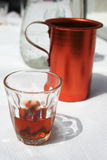 Red greek traditional wine jug and glass royalty free stock image