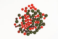 Red and green amber stones. Lie on a flat surface Stock Images