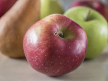 Red,green aplles with pear Stock Photography
