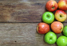 Red and green apple fruit on wood Stock Photos