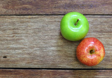 Red and green apple fruit on wood Stock Images